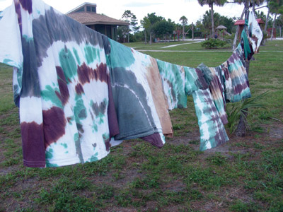 Heather Cobb, recreation specialist for the Parks, Recreation and Conservation Department, helped campers learn to tie-dye camouflage shirts between fishing and swimming May 18.