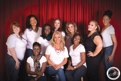 Lorianne De Loreto, CEO and Founder of Visions of Hope International, sits surrounded by her models and staff for the organization's first philanthropic charity event, Breaking Free: Silent no More.Mauricegardner.net photo