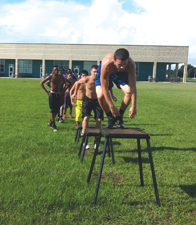 Lennard players are put through their paces by coaches during a recent practice session at the Ruskin school. Kevin Brady photo