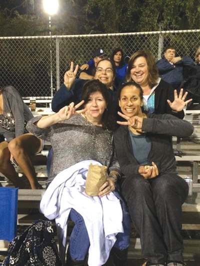 Cheering on the Sharks at a baseball game earlier this year were  Riverview High PTSA members, back row, Susan Shapiro, left, and Maria Ortiz and, front row, Dabney Whitt, left, and Michelle Battle. Photo courtesy of Michelle Battle.