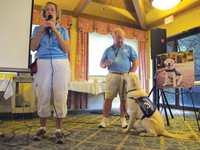 """Nancy and George Cottrell are """"puppy raisers"""" of Gunner, an ambassador dog with Southeastern Guide Dogs. Though not used as a guide dog, Gunner goes to assisted living facilities, libraries and to reading programs for children.  Lia Martin photo"""