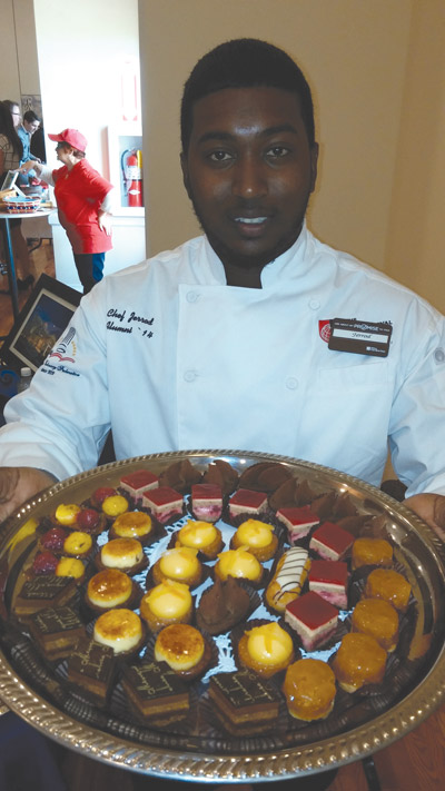 The dessert table of Jerrod Seeberan, a chef at Riverview's Hilton Garden Inn, drew rave reviews at the luncheon. Kevin Brady photo