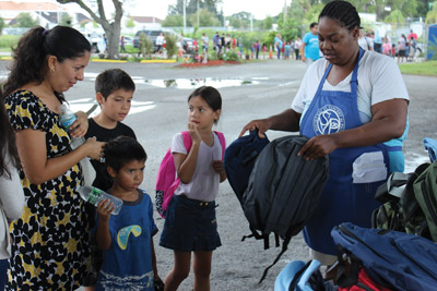 Youngsters get free backpacks Tuesday from St. Vincent dePaul Society. Jacob Council Photo