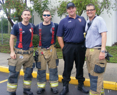 After making sure everyone was all right and there was no danger of fires, Captain Scott VanDeboe, right, and his men, from left, Scott Vittoe, C.J. West and Claudio Glerman, take a quick break. Penny Fletcher photo