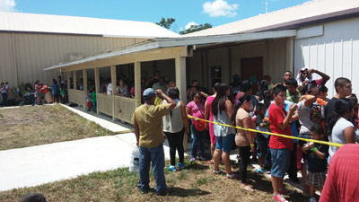 Parents and students lined up around the building to receive new packpaces that also included school supplies.