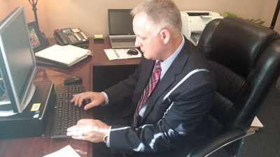 Darrell Faber, the new principal at Eisenhower Middle School, gets to work on his first day. Kevin Brady photo.