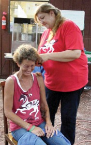 Dawn Radomski of Tampa gets a shave in memory of her mother Mary Breen, who died in 2009.