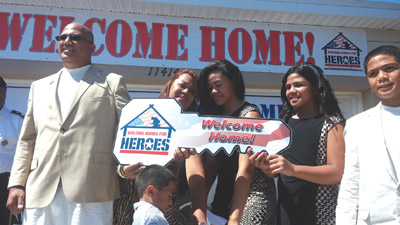 U.S. Army Sgt. Visala Tui and his family are handed ceremonial keys to their new home in the Hibiscus Island community in Riverview. Kevin Brady photo.