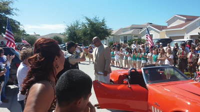 Sgt. Visala Tui and his family arrived in style for the ceremony, ushered in by a procession of classic cars. Kevin Brady photo.
