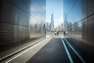 The new One World Trade Center as seen through the Empty Sky Memorial, dedicated to and containing the names of the 746 people from New Jersey who lost their lives on September 11, 2001. The new tower, expected to be fully completed this year, stands at a symbolic 1,776 feet and is the tallest building in the Western Hemisphere. Mitch Traphagen photo.