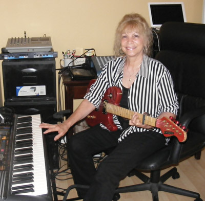 Cyndi Burger plays guitar, keyboard and harmonizes with herself. Thanks to new technology that allows her to lay down tracks for any instrument she wants to accompany her, she sounds like a whole band as she performs songs from the early 1900s through current songs of today.  Penny Fletcher photo.