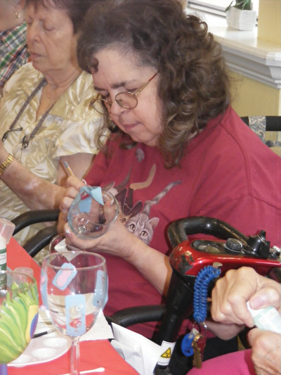 Pictured at right, Debbie Early concentrates hard on her design. Penny Fletcher photo.