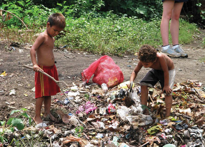 Children, many without any parents following a hurricane, sifted through garbage, foraging for something to eat. Photos courtesy of Sarah Woodard.