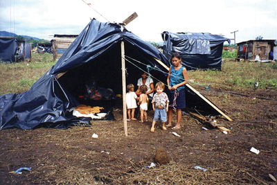 When shelter was finally provided for the people who suffered a loss of everything they had from Hurricane Mitch in October 1998, it was nothing more than these tarps. There was no running water and very little food.
