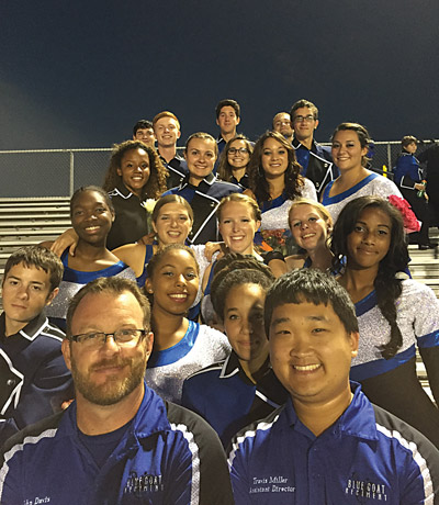 Band director John Davis (left) and assistant Travis Miller (right) with 18 seniors Oct. 18 at Senior Night. Travis Miller photo.
