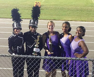 Senior student officers, from left, Deputy Drum Major Shara Crane, Drum Major Jasmine Cherry, Color Guard Captains Lindsay Dible, Emerald Armstrong and Jayla Lewis after victory at Durant High School's West Coast Invitational, where the Sharks won Best Color Guard overall and 2nd in class 4A.