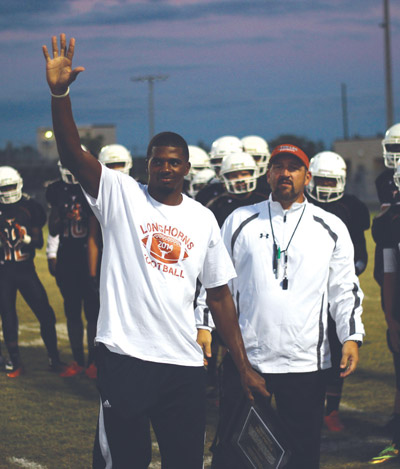 Fred Porter, above left, was honored at the Lennard-Leto game last Friday. He is the first Lennard High School graduate to play for a Division 1 college. Porter is a wide receiver at Florida International University in Miami. He played youth football for the Progress Village Panthers and the East Bay Buccaneers.