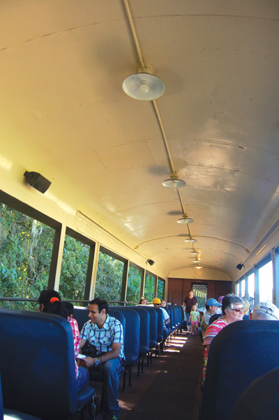 This open-air coach felt a lot like riding on a school bus. The original industrial-looking lighting see here has become popular again in today's decorating themes.