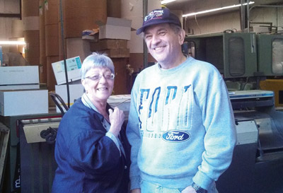 Every Wednesday, Beverly Kay could be found in the press room at M&M Printing, overseeing the final leg in the weekly journey of The Observer News. She is pictured above with one of her carriers, Frank Blaszczak. Anyone who meets Beverly walks away with a smile. Strangers become friends easily. Beverly will be missed by everyone at The Observer News and M&M Printing.