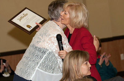 Hillsborough County Commissioner Sandra Murman hugs Anne Madden as she presents the Distinguished Service Award to Madden for her two decades of community service.