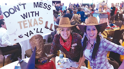 Sarah Brezik, right, and Janice Hope of White Lodging Hotels took the silver for their table's Texas motif.  Kevin Brady photos.