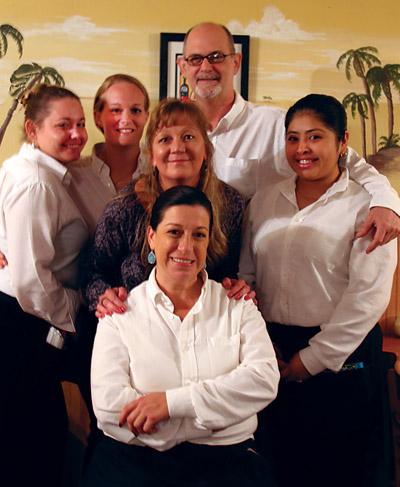 The staff at Ybor Grille. Seated is Nancy Homs. Standing left to right: Amber Spencer, Sarah Maddox, Kelli Marthey, Meshach Davis and Jesenia Sanchez.