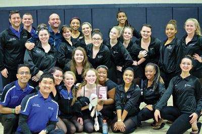 The ladies of Blue Radiance with director Herman Rios (back row, third from left) joined by staff members and the Band Program administrative team at Durant High School after winning first place in Class AAA and being promoted to Class AA on Jan. 24. Travis Miller photos.