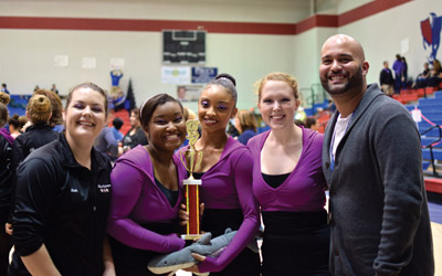 Enjoying their victory in Orlando Saturday are, from left, flag lieutenant Leah Smith, captain Jayla Lewis, assistant captain Emerald Armstrong, captain Lindsay Dibble and director Herman Rios.