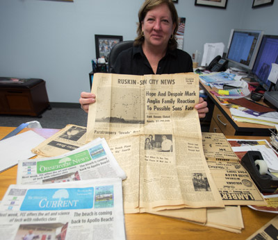 Chere Simmons, editor and creative director of The Observer News publications, holds history in her hands — a Ruskin newspaper from 1962 that would later become The Observer News.