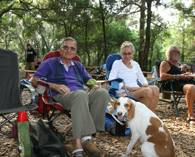 Ed Feder and Phyllis Laufer relax during the concert with Ed's foxhound Skyler at their feet