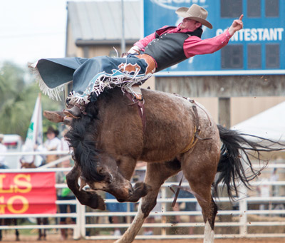Kyle Brennecke of Grain Valley, Mo., makes it clear that saddle bronc riding can involve some pain for the rider. Brennecke held on to the end.
