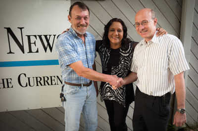 David Payne and Karina and Wesley Mullins are the new owners of The Observer News family of publications through a purchase deal that was completed last week, after five years of work. Wes Mullins has been CEO for more than 10 years. Payne came to the company six years ago from a 29-year career at the Bradenton Herald. Mitch Traphagen photos.