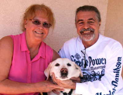 Dennis and Juanilla Lubrano relax at home in Apollo Beach with their 14-year-old yellow Lab, Bubba.  Lisa Stark photo. LisaStark.com.