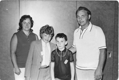 John Cheevers, left, and Kevin Brady, two of the first six children to visit the U.S. with Project Children, arrive at JFK Airport in 1975 to meet their host family, Carol and Duke Hoffman. The Hoffmans eventually adopted both boys so they could remain in New York and complete their higher education.