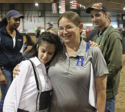 Teacher Karen Hamilton congratulates Angela Lander after the 2015 Florida State Fair earlier this year. Photos courtesy of Sassy Cows 4 Savvy Kids.