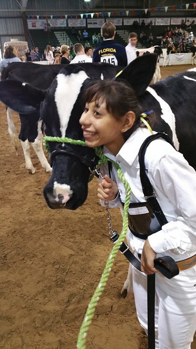 Veronica Poncia with her cow, Apple.