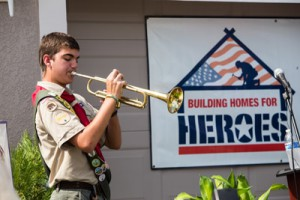 William Siverten, a bugler with Boy Scout Troop 061 in Valrico, plays America the Beautiful during the ceremony.