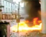 A news clip of a gasoline bomb igniting on the streets of Belfast, Northern Ireland, during The Troubles era.