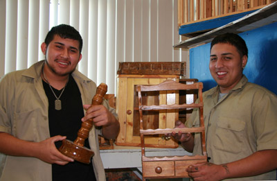 Everado Hernandez and Jeremiah Melendez display some of the projects that have been produced this semester in Mr. Dutton's class.