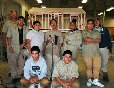 The class poses in front of a structural model they have built to scale. Back row, from left: Teacher Ken Dutton, Everado Hernandez, Vanessa Vega, Hector Espinoza, Christine McMillan, Jeremiah Melendez and Marvin McClendon.  Front row: Pablo Rodriquez and Jovany Saldana.