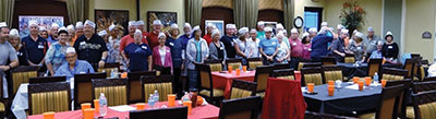 The Illinois Club of Valencia Lakes ready to enjoy their Portillo's meal that was sent from the Chicago restaurant just for this event. Harry Ross photo.