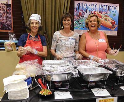 More than 25 volunteers set up and served the club's meal. Elisabeth Tsang photo.