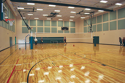 The spacious, 7,000-square-foot gym has basketball hoops that completely retract and also can be raised up and down for different skill levels.