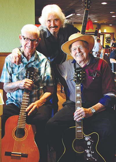 """From left, Harold """"Guitar Man"""" Potter with fellow musicians Ivan and Frank Mullins. Lisa Stark photo."""