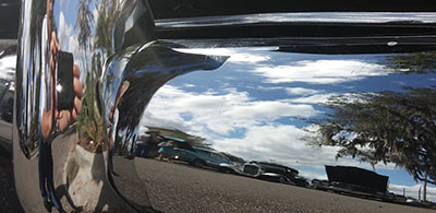 The fundraiser also included a classic car show, some of which are seen here reflected in the bumper of a 1942 Chevy Coupe.
