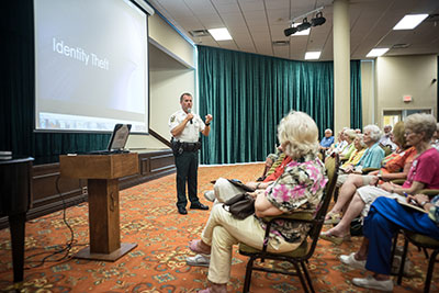 HCSO Sun City Center Community Resource Deputy Jeff Merry gives a presentation on identity theft last summer. It was one of numerous free seminars he provided throughout the community.