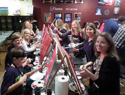 Budding artists enjoy an evening of art, companionship and fun at Pinot's Palette in Brandon.