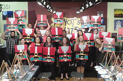 Students at Pinot's Palette display their holidays paintings, titled Countdown to Christmas.