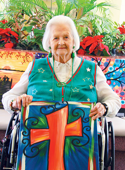Cypress Creek resident Mary Jo Gluff shows off her new painting from Pinot's Palette. Lisa Stark photos.