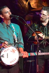 lisa shay photo Doug Harnish plays banjo and Ross Godfrey plays mandolin during the performance by the Faceless Bandits